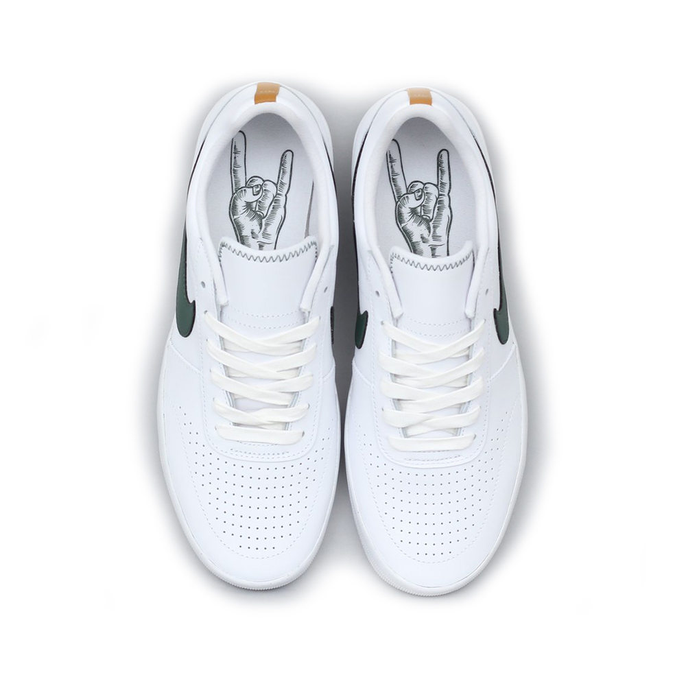 """The Nike SB Team Classic PRM by Guy Mariano. Made from high quality leather together with a durable rubber sole. White and galactic jade color scheme with the classic nike swoosh. Now in stock the Nike SB Team Classic PRM by Guy Mariano. A Laced Shoe with closed nose by Nike called the Nike SB Team Classic PRM by Guy Mariano made of high quality leather together with a durable rubber sole. The rubber sole of the Team Classic PRM by Guy Mariano has a waffled like texture foraccellerated board feel. Team classic PRM is also equipped with La Mano Cornuta on the inlay sole which means """"The Horned Hand"""" in Italian, a good luck charm and protection against the Evil Eye. According to Guy Mariano this shoe with ultra clean silhouette reminds him of his favorite pasta dish. Productcode: AR0767101 This Shoe Nike SB Team Classic PRM has a galactic jade green with color scheme. If ordered now it will be at your door at high speed by fast shipping. Want to find fitting apparel? SeeApparel by Adidascombine it with other brands in our webshop in theShoesApparelHeadwearSpecialsHardwareAccessoires. More info can be found at the online headquarters ofAdidas Skateboarding. Don't forget to check out oursalepage to get lucky. Fier skateshopis based in Dordrecht and is the number one skate shop in the Drechtsteden for shoes, clothing, hardware, service and a big smilewhen it comes to skateboarding. Also follow us on social mediaInstagram,Facebookto make sure you're up to date with new products and specials."""
